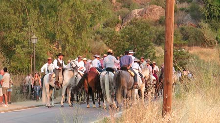 patron : Alora, Spain - August 26, 2018: Group of local horsemen forming advanced honor guard for the annual procession in honor of Flores, patron saint of Alora, Andalusia