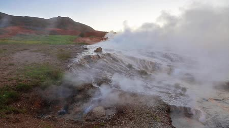 strokkur : Misty morning in geothermal valley Haukadalur on the slopes of Laugarfjall hill. Southwestern Iceland, Europe. Full HD video (High Definition). Stock Footage