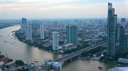 night scape : This unique video shows the busy city of Bangkok in Thailand in a time lapse from evening to night. You can see the boats driving on the river and the cars on the streets
