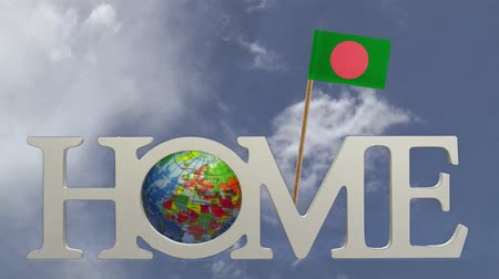 fogpiszkáló : Spinning earth  in the word Home and a tooth pick with a small paper flag of BANGLADESH