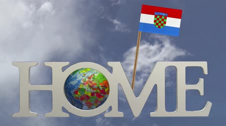 hırvatistan : Spinning earth  in the word Home and a tooth pick with a small paper flag of CROATIA Stok Video