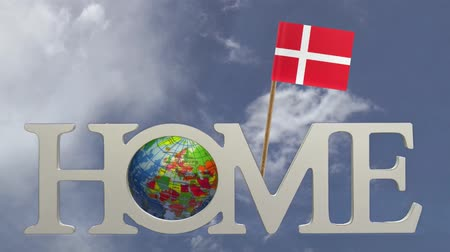 fogpiszkáló : Spinning earth  in the word Home and a tooth pick with a small paper flag of DENMARK