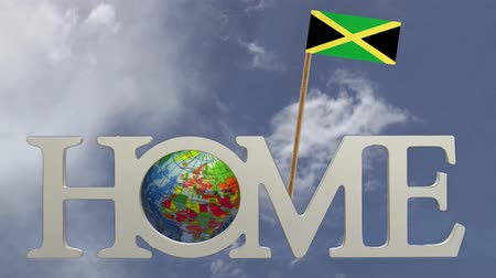 fogpiszkáló : Spinning earth  in the word Home and a tooth pick with a small paper flag of JAMAICA