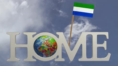 sierra leone flag : Spinning earth  in the word Home and a tooth pick with a small paper flag of SIERRA LEONE
