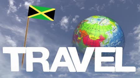jamaica : The word travel and a turning globe  in front of a blue sky with tooth pick and a small paper flag of  JAMAICA
