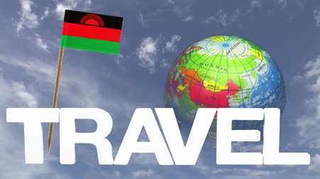 malawi : The word travel and a turning globe  in front of a blue sky with tooth pick and a small paper flag of  MALAWI Stock Footage