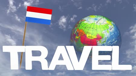 fogpiszkáló : The word travel and a turning globe  in front of a blue sky with tooth pick and a small paper flag of  NETHERLANDS