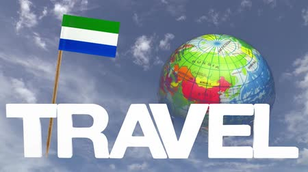 sierra leone flag : The word travel and a turning globe  in front of a blue sky with tooth pick and a small paper flag of  SIERRA LEONE