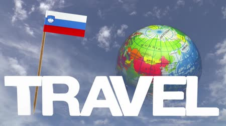 вокруг : The word travel and a turning globe  in front of a blue sky with tooth pick and a small paper flag of  SLOVENIA Стоковые видеозаписи