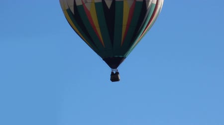 kaktusz : Hot air balloon floating away to left full shot