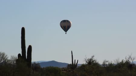 Hot air balloon over desert wide shot