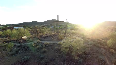 Wooden Cross on hill in desert sunset Wideo
