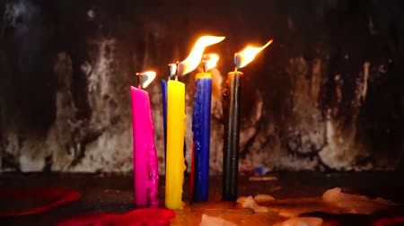 knot : Colorful candles blowing in the wind