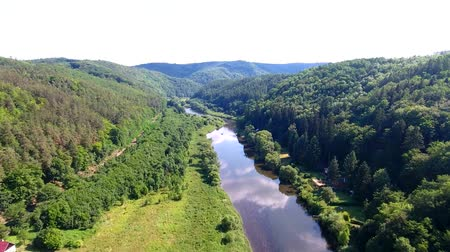 Čechy : Aerial drone footage over Berounka River near Krivoklat landscape, Czech Republic, Europe