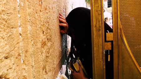 jewish prayer shawl : Jerusalem Israel June 18, 2018 view of a woman praying at the Western Wall in the morning
