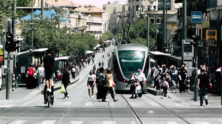 por que : Jerusalem Israel June 20, 2018 View of the tramway of Jerusalem and unknown people walking in Jaffa street in the morning
