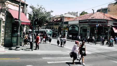 troli : Jerusalem Israel June 20, 2018 View of the tramway of Jerusalem and unknown people walking in Jaffa street in the morning