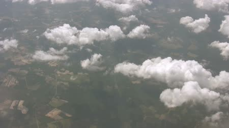 samoloty : An aerial view soaring through the clouds with a view of the earth below.