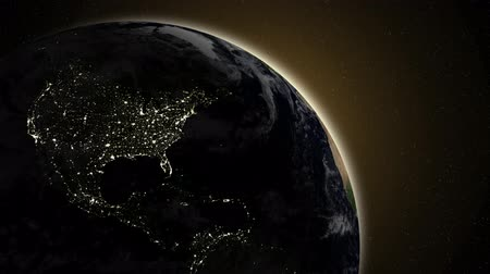 telekomünikasyon : A view of city lights on the night side of the earth as the sun rises over the horizon.