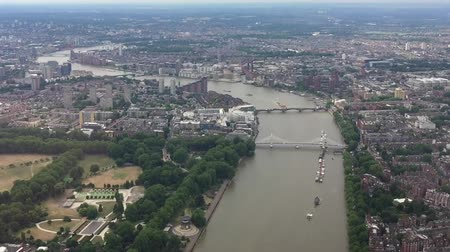 központi : Helicopter view of London buildings and Thames bridges Stock mozgókép