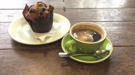 expressed : Cup of coffee with chocolate muffins