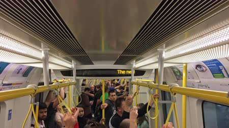 velocímetro : LONDON? SEPTEMBER 2016: People inside a moving subway train. London subway is a very efficient way to move in the city