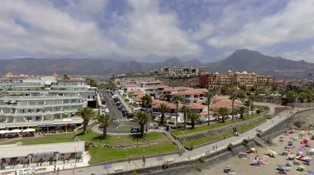 kanarya : TENERIFE, SPAIN: Flying over Playa de Las Americas. The beach is the most famous of the whole island Stok Video