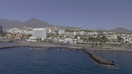 kanarya : TENERIFE, SPAIN: Aerial view of Playa de Las Americas buildings. The beach is the most famous of the whole island Stok Video