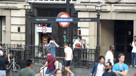 LONDON? JULY 2015: Tourists and locals at subway station entrance. London attracts 30 million people annually Stok Video