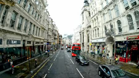 LONDON - JUNE 2015: Street view from a bus on rainy day. London attracts 15 million tourists annually