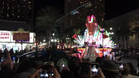 бисер : NEW ORLEANS - FEBRUARY 9, 2016: Floats parade with crowded streets at night. Mardi Gras is the main carnival event in New Orleans