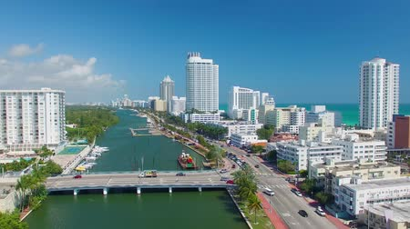 sul : MIAMI, FL - FEBRUARY 2016: Aerial view of Miami Beach buildings along the river. Miami attracts 15 million tourists annually