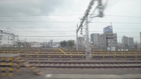 shinkansen : TOKYO, JAPAN - MAY 2016: The Shinkansen train in transit train station in Tokyo, Japan. Shinkansen is a network of high-speed railway lines in Japan. Stock Footage