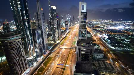 эмираты : Dubai Sheikh Zayed Road by sunset with heavy traffic streets