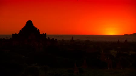 mianmar : Time lapse Beautiful sunrise over the ancient pagodas in Bagan, Myanmar.The capital of the ancient Pagan Kingdom  located in the Mandalay Region of Myanmar.Bagans prosperous economy built over 10,000 temples between the 11th and 13th centuries.