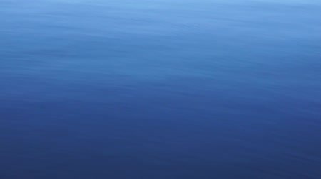 Deep blue body water at a lake with a gentle ripple movement on its surface