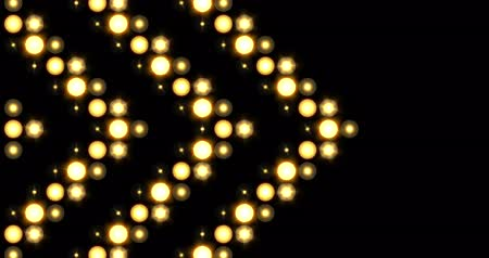 Yellow nightclub stage backdrop LED matrix panel lights arrow pattern visual on a black background, animated in a twinkling sideways movement motion.