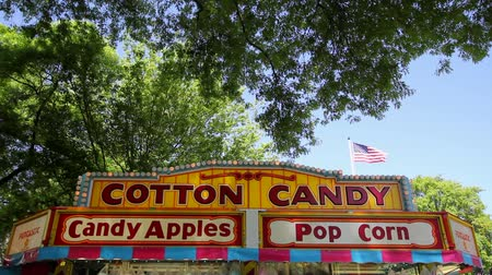 adil : Cotton Candy Stand Signage in Carnival Festival one Sunny Blue Sky Day 1920x1080 Stok Video