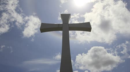 templombúcsú : Crucifix Cross with Sun Flare Timelapse with Moving White Clouds against Blue Sky 1920x1080