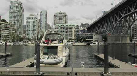 yanliŞ : Water Traffic with Seabuses Taxis and Highrise Condominium Buildings along Burrard Inlet in Granville Island Vancouver BC Canada 1080p