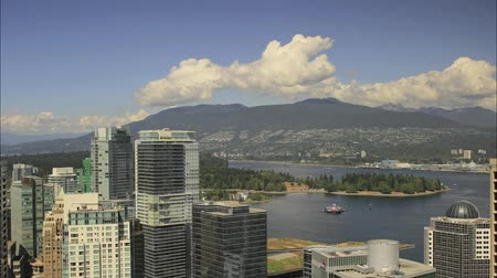 apartamentos : Vancouver BC British Columbia Canada with Scenic View of Office Condominium Buildings Clouds Grouse Mountain Stanley Park and Moving Boats in False Creek Time Lapse 1080p Stock Footage