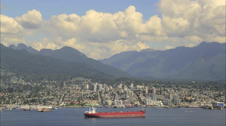 konténer : Urban Scenic View of North Vancouver BC from Gastown in British Columbia Canada with Moving White Clouds Blue Sky and Water Traffic Transportation Timelapse 1920x1080