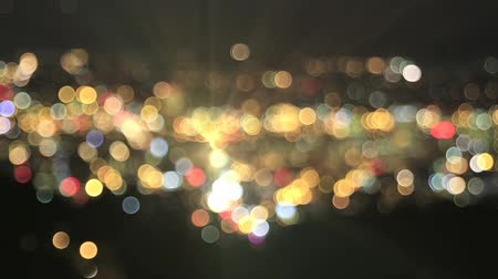 bulanık : Defocused City Lights with Moving Car Beams Colorful Bokeh Background Time Lapse 1920x1080