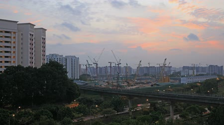 Singapore Public Housing Development Construction Cranes and Freeway Light Trails in Punggol Estate at Colorful Sunset Time Lapse 1920x1080