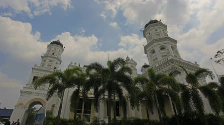 southeast : Sultan Abu Bakar State Mosque located along Jalan Skudai, Johor Bahru, Malaysia with Moving White Clouds and Blue Sky Time Lapse 1080p. It was constructed between 1892 and 1900.  Stock Footage