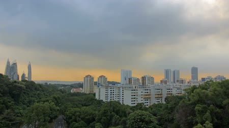 bydlení : View of Planned Public Housing HDB Apartment Flats and Condominiums Buildings in Singapore at Colorful Sunset with Moving Clouds Time Lapse 1080p