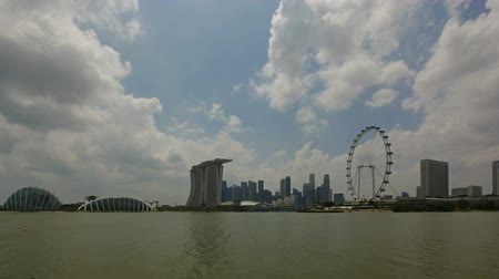 southeast : Downtown City Skyline along Singapore River Waterfront with Moving Water White Clouds and Blue Sky Time Lapse 1920x1080