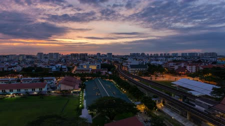 şafak : EUNOS, SINGAPORE - MAY 23, 2014: Time lapse movie of sunrise by Eunos MRT Station in Singapore. Eunos is a residential neighborhood east of the Central Area. 1920x1080