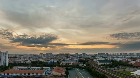 čas : Time lapse zooming out movie of sunrise and moving clouds by Eunos MRT Station in Singapore. Eunos is a planned residential neighborhood east of the Central Area. 1920x1080