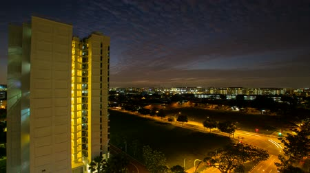 Time lapse zooming out movie of sunset and Traffic Light Trails from Eunos apartment building in Singapore. Eunos is a planned residential neighborhood east of the Central Area. 1920x1080